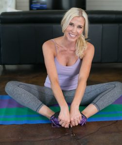 Photo of Sheri Geoffreys sitting on exercise mat getting ready to do regular exercise