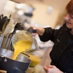 photo of Christina Lundahl pouring blended squash into pot for butternut squash cider soup