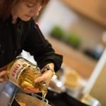photo of Christina Lundahl pouring cider into pot for butternut squash cider soup