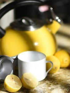 photo of warm lemon water and yellow kettle