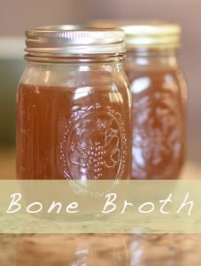 photo of beef bone broth in mason jars