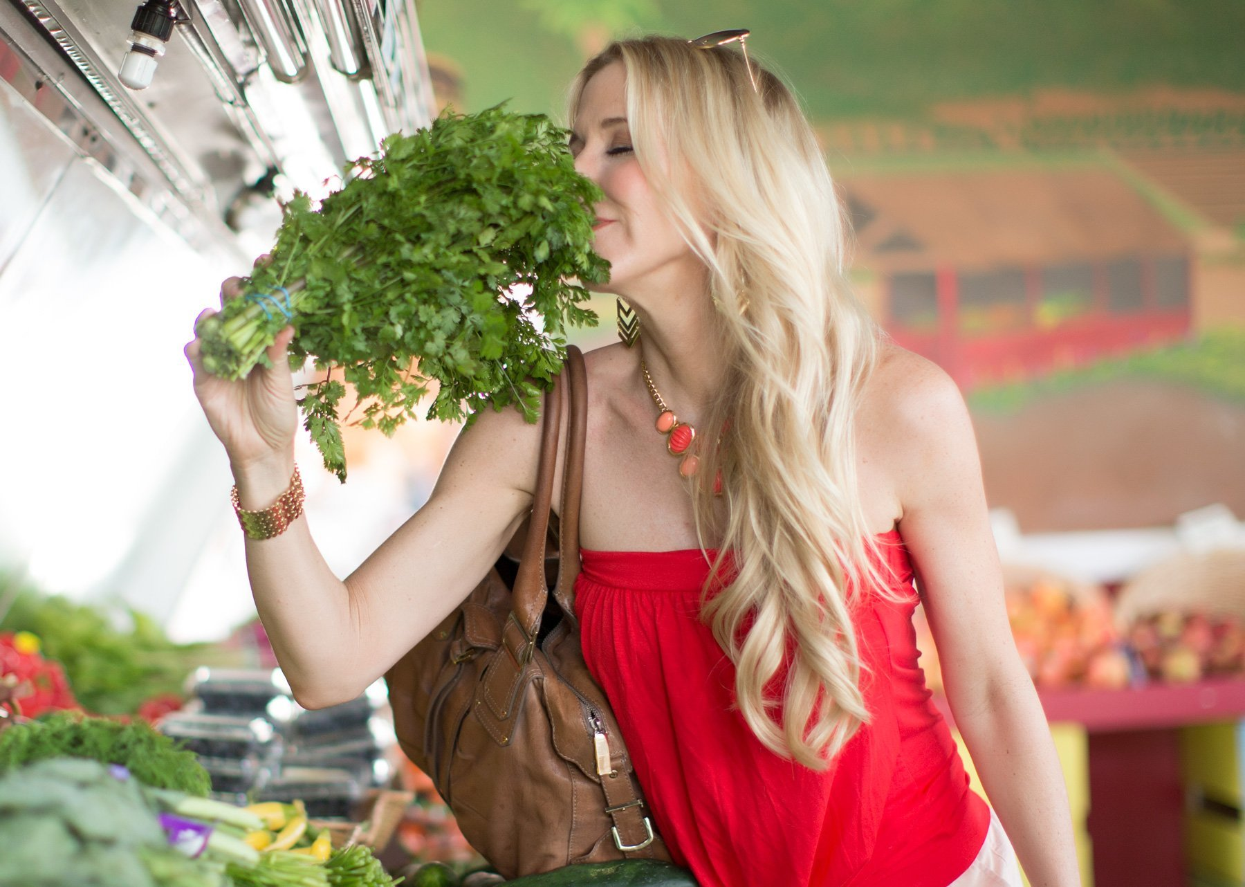 photo of Sheri Geoffreys smelling cilantro at the store