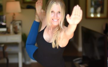 photo of Sheri Geoffreys with leg outstretched doing heated yoga