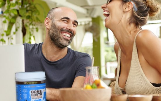 photo of people laughing with GracieBloo Bone Broth Collagen Protein Powder in the forefront
