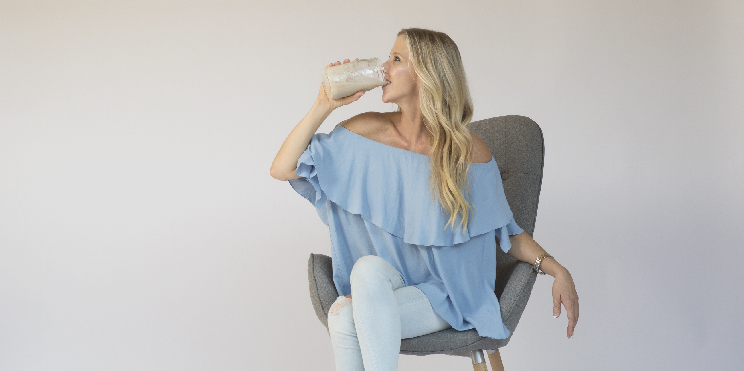 photo of Sheri Geoffreys drinking protein smoothie for wellness