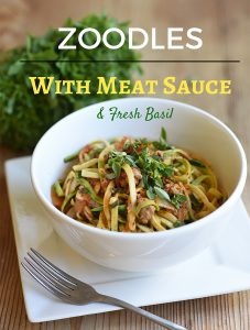 Photo of zoodles with meat sauce and fresh basil